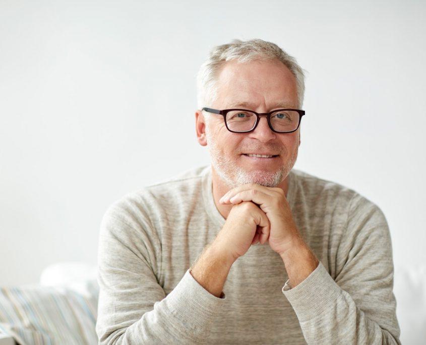smiling senior man in glasses o2dental Vancouver